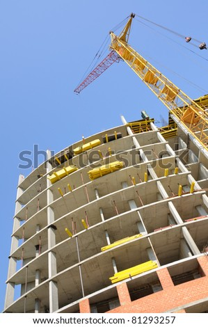 construction crane and building - stock photo