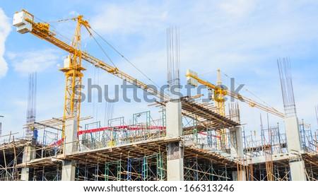 Construction crane building tower - stock photo