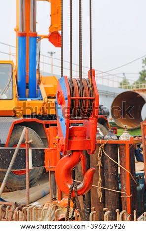 construction crane hook - stock photo