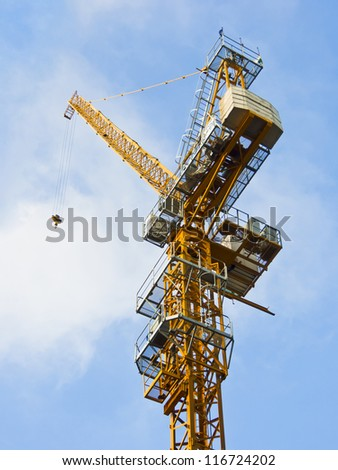 construction crane in blue sky background - stock photo