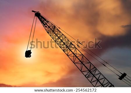construction crane on evening background - stock photo