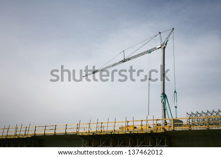construction cranes for lifting heavy loads - stock photo