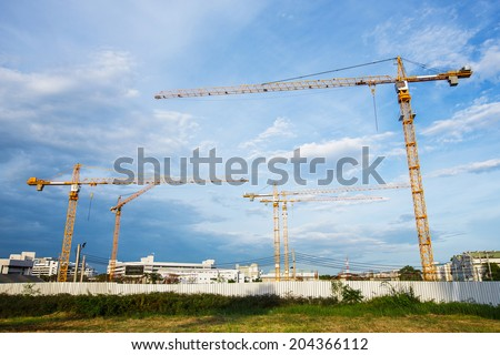 construction cranes in the blue sky - stock photo