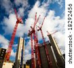 construction cranes with clouds - stock photo