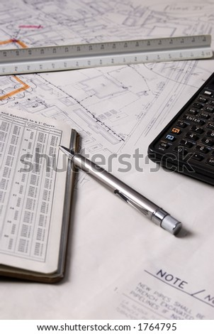 Construction drawings laid across a table