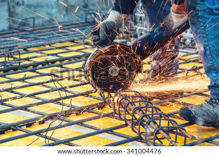 construction engineer using a circular saw cutting reinforced steel and bars  - stock photo