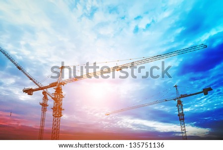 construction equipment and elements of a building under construction at Sunset - stock photo