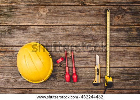 Construction equipment and tools on wooden table. Concept photograph taken from above, top view. Do it yourself theme with copy space. - stock photo