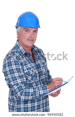 Construction foreman evaluating an employee - stock photo
