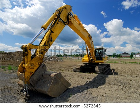 Construction Front End Loader With Large Excavating Bucket Attached - stock photo
