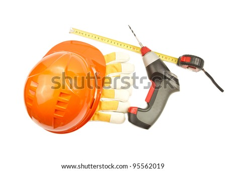 Construction hard hat, roulette, gloves, drill isolated on white background