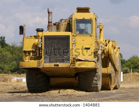 Construction Heavy Equipment Scraper - stock photo