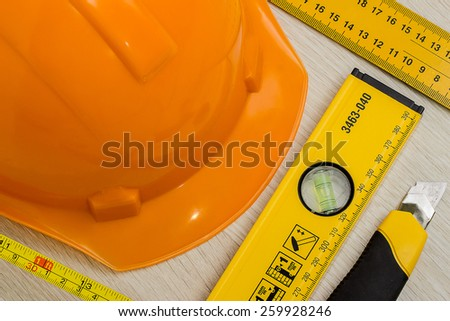 Construction helmet and tools. background - stock photo