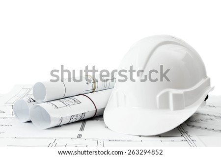 Construction house. Repair work. Drawings for building and helmet on white a background. - stock photo