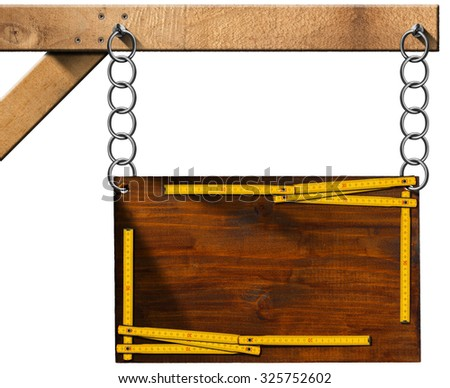 Construction Industry - Sign with Chain / Wooden sign for construction industry with old wooden ruler. Hanging from a metal chain on a pole and isolated on white background - stock photo