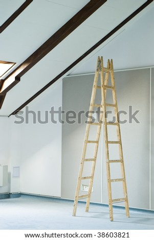 construction interior with stepladder and wall - stock photo