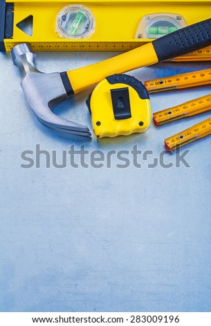 Construction level tape line claw hammer wooden meter on metallic background copy space image maintenance concept