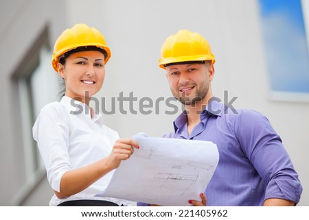 Construction manager and engineer woman working on building site - stock photo