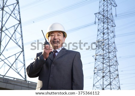 Construction manager on walkie talkie - stock photo