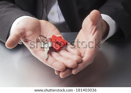 construction manager with kay in hands - stock photo