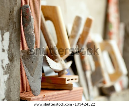 Construction mason cement mortar tools in a row - stock photo