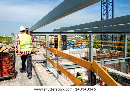Construction of a modern building and a skyscraper - stock photo