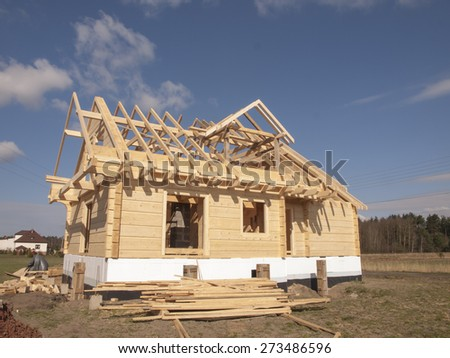 construction of a wooden house with thick logs rectangular - stock photo