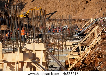 Construction of an industrial building deep foundation pit - stock photo