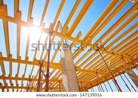 construction of an industrial plant floors with yellow i-beams - stock photo