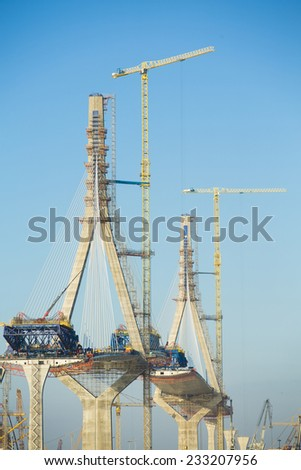 Construction of big guyed bridge in Cadizover the sea - stock photo