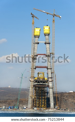 construction of big guyed bridge in the russian Vladivostok over the Eastern Bosphorus strait to the Russky Isle - stock photo