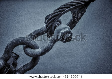 Construction of cables. A strong link. holding ships to the wall. - stock photo