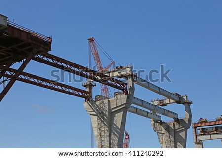 construction of concrete high speed way with heavy equipment - stock photo