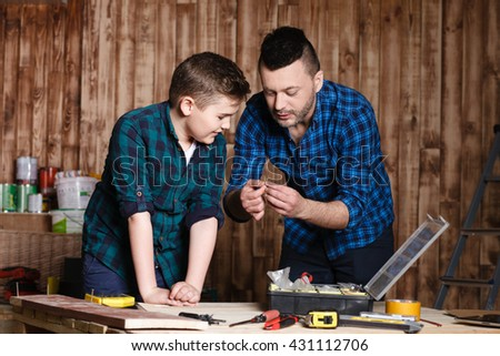 construction of father and son in the garage,  family concept
