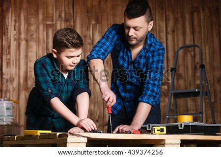 construction of father and son in the garage, family concept and construction