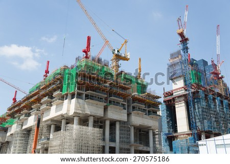Construction of high-rise buildings in Singapore - stock photo