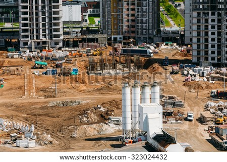 Construction of houses in a residential area. Construction site. Construction of multi-storey residential house - stock photo