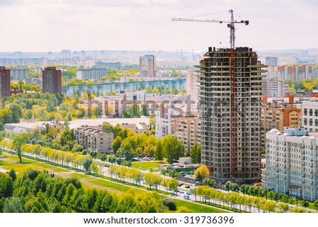 Construction of houses in a residential area in Minsk, Belarus - stock photo