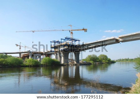 Construction of motorway bridge over the river - stock photo
