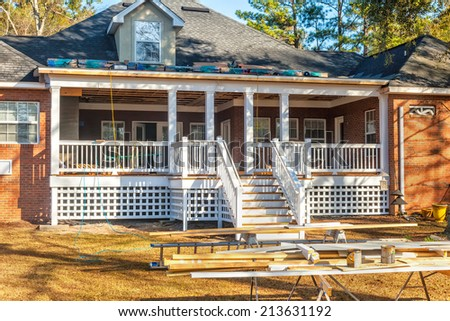 Construction of new deck at residential house - stock photo