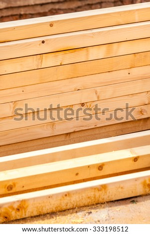 Construction of new wooden house. Beams frame close up - stock photo