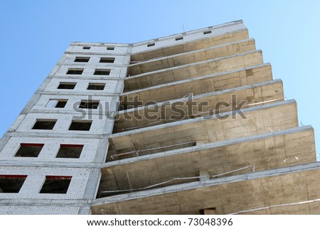 Construction of office building from glass and concrete - stock photo