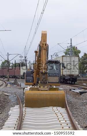 Construction of railway tracks using excavators - stock photo