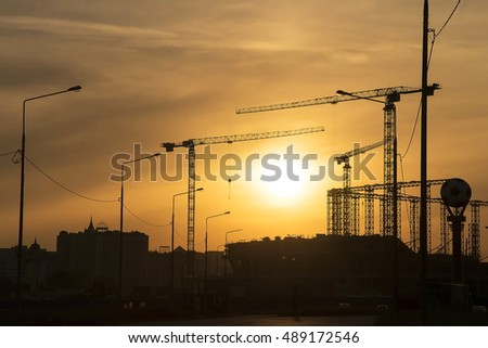 construction of stadium against the background of the sunset sun