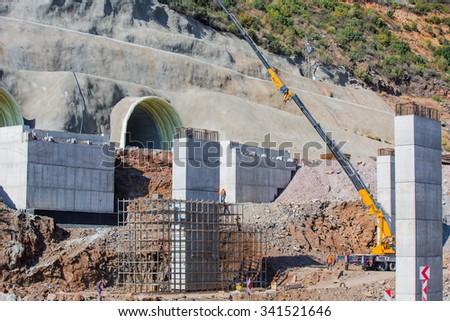 Construction of the bridge by the prestressed concrete method - stock photo