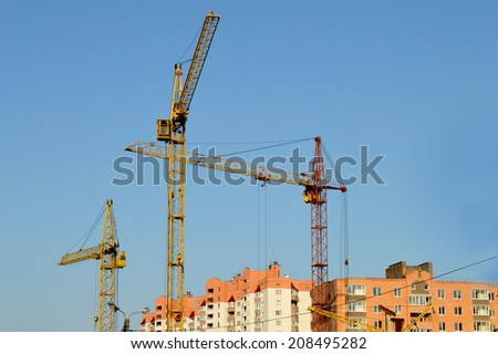 Construction of the new brick building by means of the elevating crane on open space