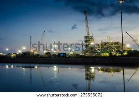 Construction oil refinery in night - stock photo