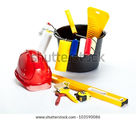 Construction (painting) tools and hardhat on white background