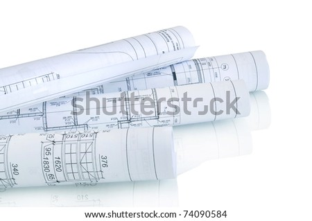 construction plan in rolls isolated on white with reflection - stock photo