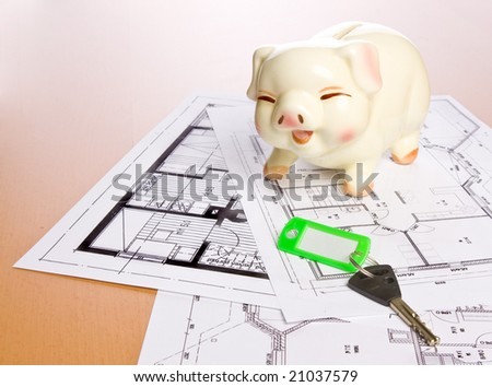 Construction plan with piggy bank as symbol for building a house